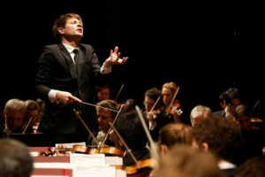 Krzysztof conducting the orchestra