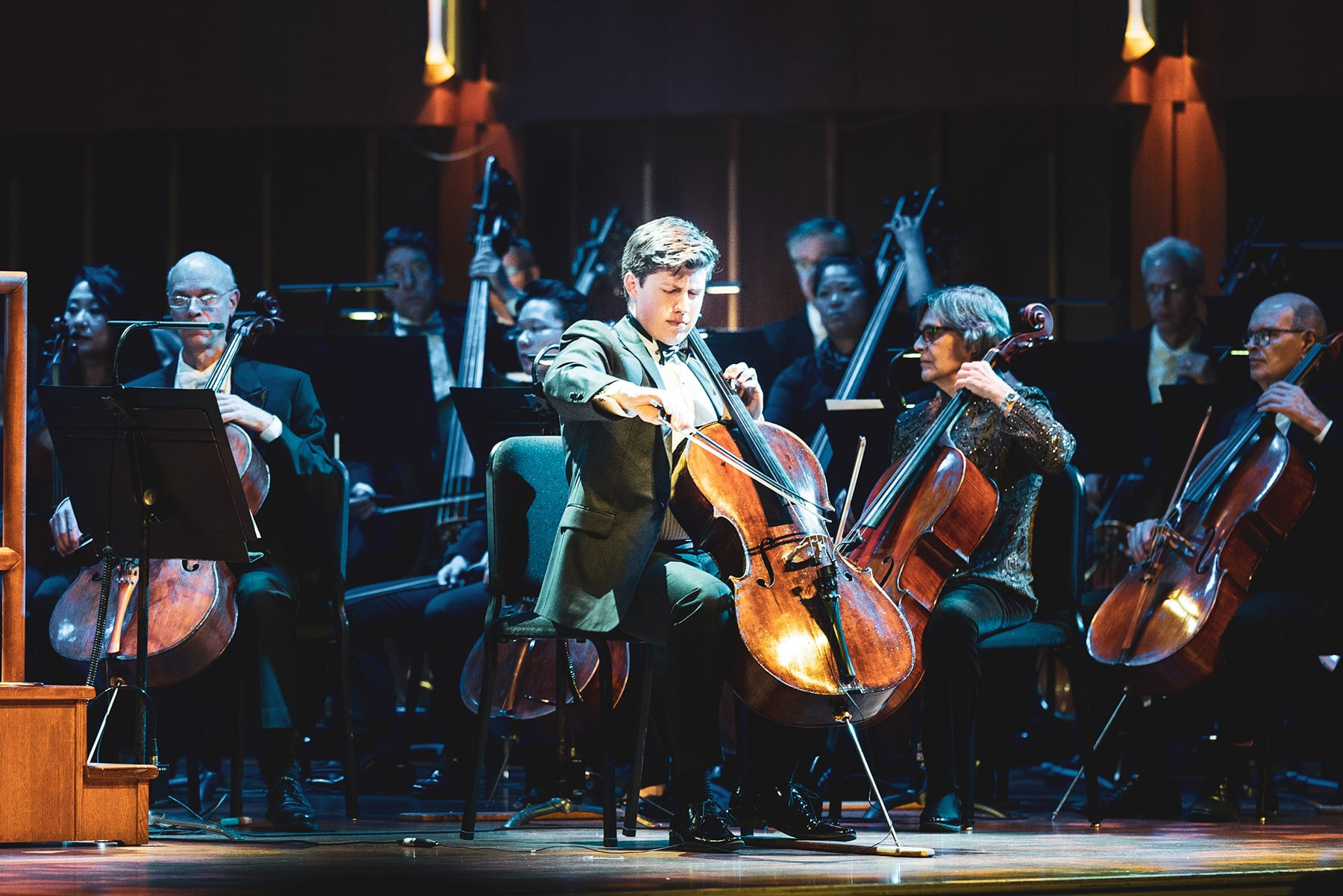 Man playing a cello solo on stage