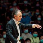 Jun conducting an orchestra