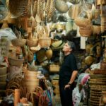 Jun standing, surrounded by baskets